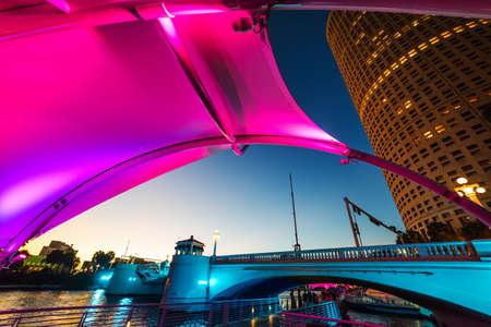 Colorful shelter in Tampa riverwalk at night. Florida, USA