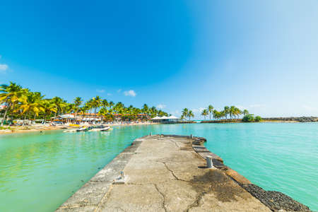 Cement jetty in Bas du Fort beach in Le Gosier, Guadeloupe island. French west indies, Lesser Antilles