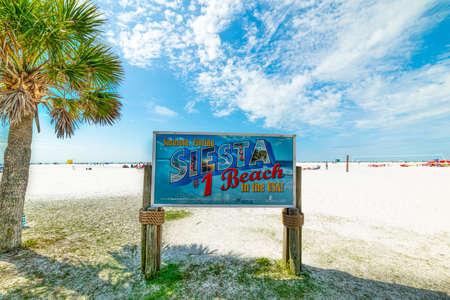 Sarasota, USA - February 25, 2019: Siesta Beach sign on a clear day