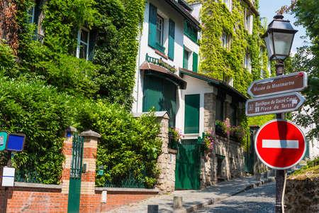 Narrow street in Montmartre neighborhood. Paris, France