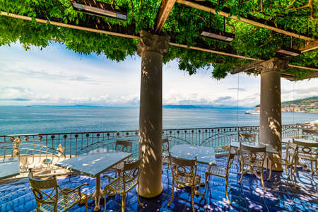 Tables and chairs on a beautiful terrace in Sorrento, Italy