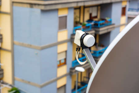 Close up of a satellite dish and LNB on a balcony