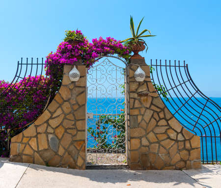 Small gates by the cliff on a clear day in Positano, Italy 写真素材