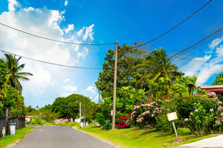 Clouds over a picturesque country road in Guadeloupe. Lesser Antilles, Caribbean sea