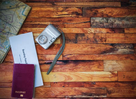 Passport, boarding pass, camera and map on a wooden table 版權商用圖片