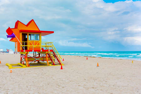 Red and orange lifeguard tower in Miami Beach on a cloudy day, USA Фото со стока - 134854229