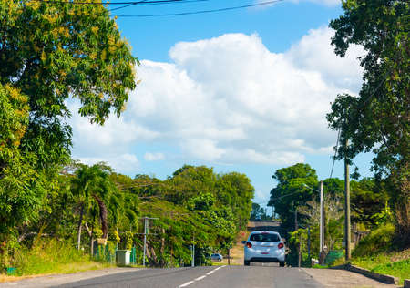 Car on a country road in Guadeloupe, French west indies. Lesser Antilles, Caribbean