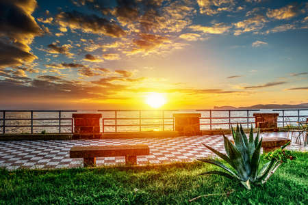 Sun shining over Alghero seafront at sunset. Sardinia, Italy Reklamní fotografie