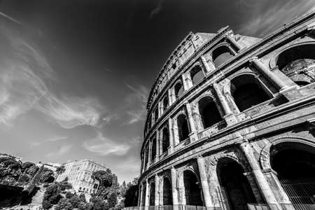World famous Coliseum under a cloudy sky, Italy. Black and white effect 스톡 콘텐츠