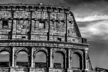 Detail of world famous Coliseum at sunset, Italy. Black and white effect