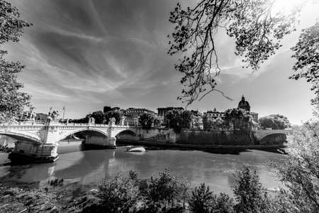 Tiber river in Rome on a sunny day, Italy. Black and white effect