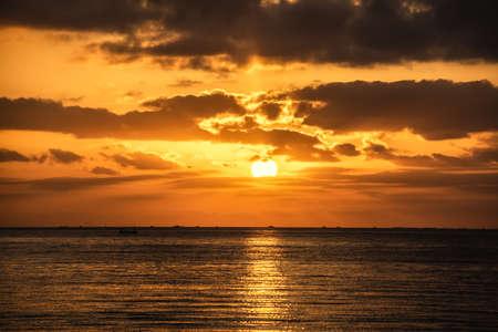 Sun shining over Alghero shore at sunset. Sardinia, Italy Фото со стока - 134865678