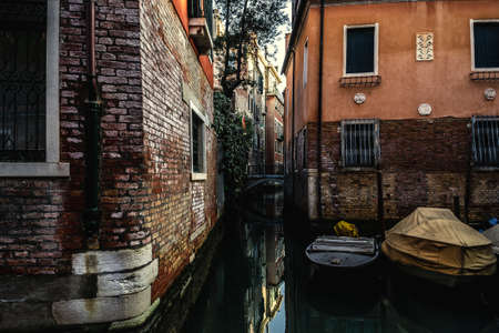 Old buildings by a narrow canal in Venice, Italy