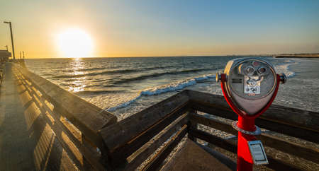 Binoculars in Newport Beach at sunset. California, USA 版權商用圖片 - 134865923