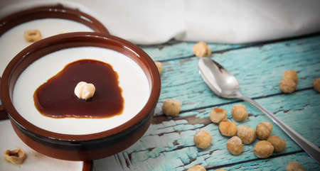 Close up of Panna cotta dessert with hazelnuts and caramel Standard-Bild - 134866058
