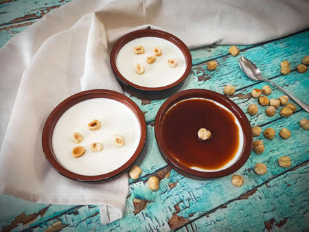 Panna Cotta and hazelnuts seen from above