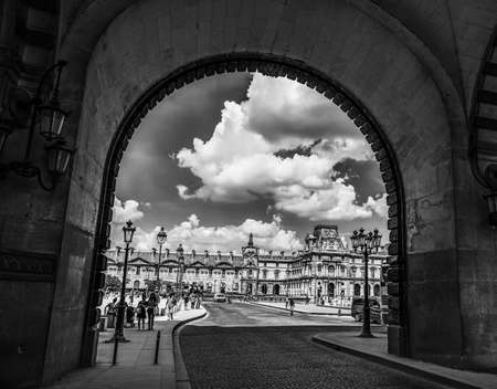 Paris, France - July 06, 2018: Arches in world famous Louvre museum in black and white effect