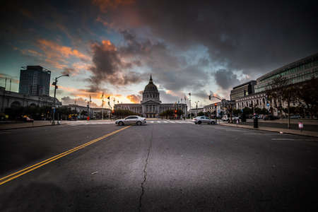 San Francisco City Hall under a dramatic sky at sunset. California, USA