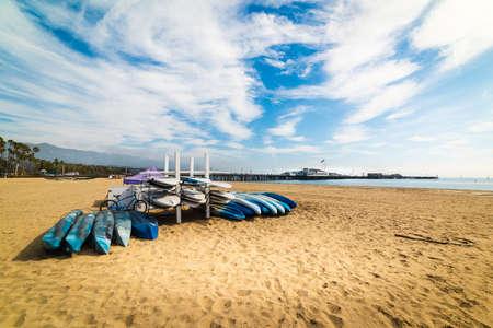 Bike, kayaks and surfboards in Santa Barbara shore. California, USA