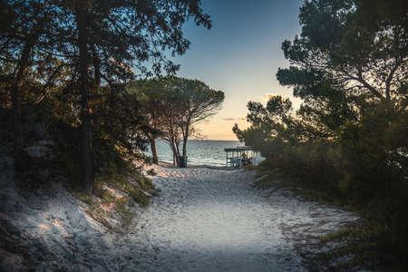 Sandy path to the beach at sunset. Alghero, Sardinia