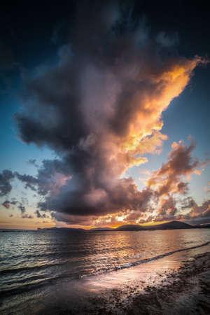 Dramatic sky over Alghero shore at sunset. Sardinia, Italy