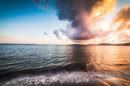 Dramatic sky over the sea at sunset. Alghero, Sardinia Reklamní fotografie