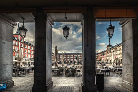 Plaza Mayor seen through surrounding colonnade. Madrid, Spain