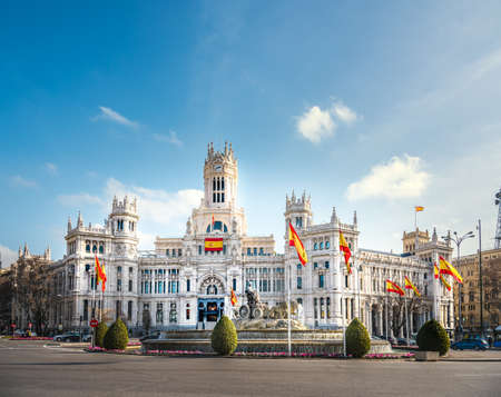 Madrid city hall under a blue sky with clouds, Spain