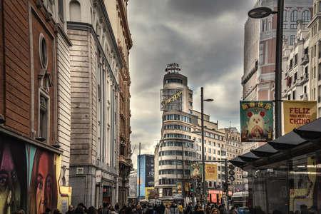 Madrid, Spain - January 24, 2020: Capitol building in Gran Via boulevard under a dramatic sky