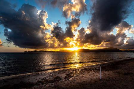 Dramatic sky at dusk over Alghero shore. Sardinia, Italy