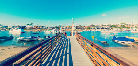 Wooden boardwalk in Balboa island, Newport Beach. Orange County, Southern California