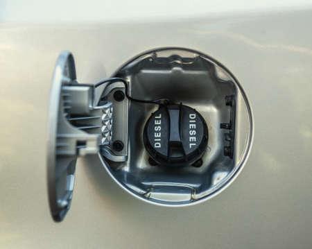 Close up of a diesel fuel cap of a grey car