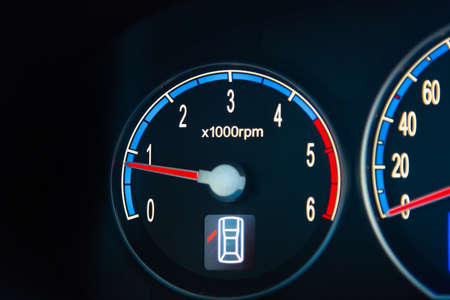 Close up of a car RPM gauge at idle speed