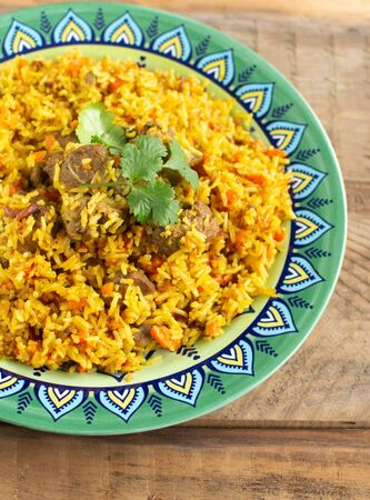Loose Indian Basmati rice seasoned with special spices with lots of onions and carrots. Foto de archivo