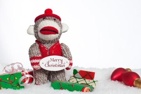 christmas sock: Christmas sock monkey with presents Stock Photo