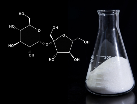 sucrose: Erlenmeyer flask with sugar and molecular formula for sucrose