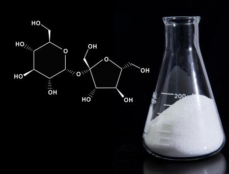 sucrose: Erlenmeyer flask with sugar and molecular formula for sucrose