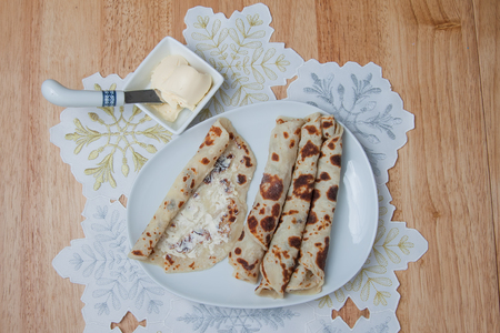 Traditional Norwegian holiday lefse served with butter Stock Photo