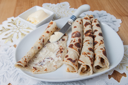 scandinavian christmas: Traditional Norwegian holiday lefse served with butter Stock Photo