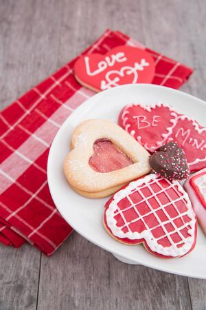 An assortment of pretty valentine cookies with a red napkin photo