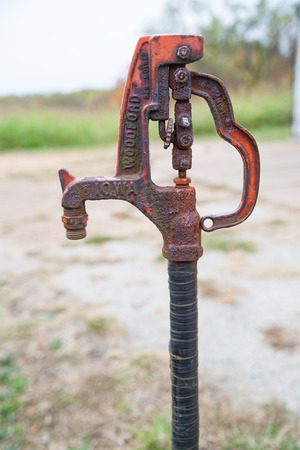 spigot: Old rusted hand pump water spigot used on a farm Stock Photo