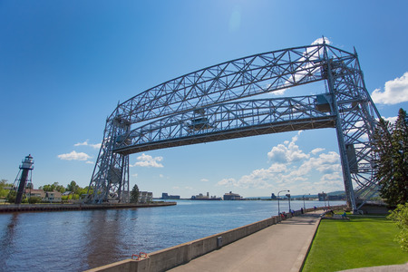 ship lift: Duluth aerial lift bridge in the raised position over the canal ready for a ship to pass through