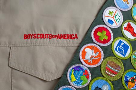 SAINT LOUIS, UNITED STATES - OCTOBER 16, 2017:  Boy Scouts of America (BSA) uniform shirt and merit badge sash Editorial