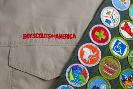 SAINT LOUIS, UNITED STATES - OCTOBER 16, 2017:  Boy Scouts of America (BSA) uniform shirt and merit badge sash Editorial