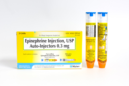 SAINT LOUIS, UNITED STATES - October 18, 2017: Mylan Generic packaging two EpiPen auto-injectors used for treatment of allergic reactions.