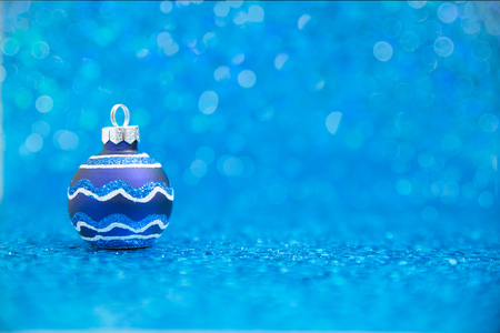 Blue striped ornament on blue twinkling background with copy space Stock Photo