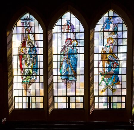 Saint Louis, United States-March 11, 2015: Stained glass window by Emil Frei Jr. at St. Gabriel the Archangel - depicts holy family, angel Gabriel