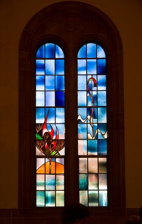Saint Louis, United States-March 11, 2015: Stained glass window by Emil Frei Jr. depicting stylized burning bush at Hope United Church of Christ