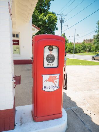 LITTLE ROCK, AK, UNITED STATES - May 30, 2018: Vintage Mobil gas pump located across the street from Little Rock Central High School, part of a national historic site.