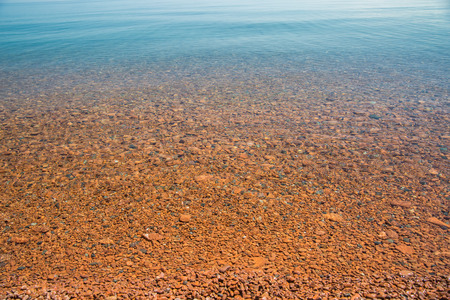 Smooth stones underwater at the shore of Lake Superior